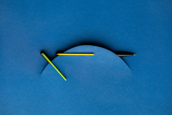 Publicidad de los bolígrafos GrafeeX amarillo y verde
