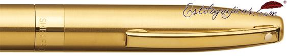 Detalle de punto blanco, capuchón y clip del bolígrafo oro de Sheaffer